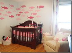 Ocean themed nursery with school of fish on wall. Get yours at www.splatterkats.com.   Find us on Facebook www.facebook.com/SplatterKats  Follow us on Twitter https://twitter.com/SplatterKats