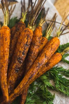 Let the natural sweetness in carrots shine through with these Cinnamon Chipotle Grilled Carrots. Only 5 ingredients make an easy side dish that is paleo, Whole30, vegan, and gluten and dairy free, perfect for for spring and summer. If you don\'t have a grill, you can also roast them in the oven! - Eat the Gains #paleo #whole30 #vegan #glutenfree