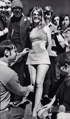 A Sixties miniskirt being measured up