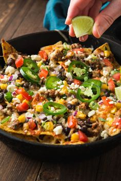 Fully Loded Nachos with Chorizo Black Beans and Corn. Ready in #hashtag