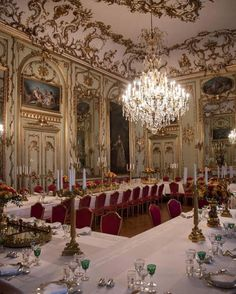 Inside the Amalienborg Palace of Denmark: A photo of the banquet table showed it decorated with candle sticks and pink, yellow, green and orange roses