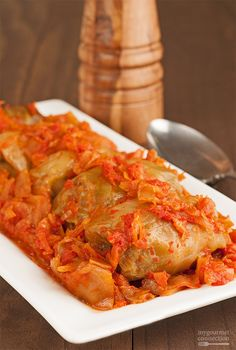 Our family recipe for Hungarian Stuffed Cabbage Rolls uses a filling of ground meat and rice and a thick tomato sauce flavored with sauerkraut, cabbage and bacon. Cabbage And Bacon, Cabbage Recipes, Meat Recipes, Stuff Cabbage, Polish Recipes, Pastry Recipes, Best Cabbage Rolls Recipe, Polish Food, Corn Recipes