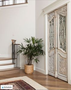 #mlinteriorsgroup #smartstylishfun #currentdesignsituation #intentionaldesign #decorinspo #entry #beautifulhome #details #handcarved # #designideas #decorinspo #homedecor #interiordesign #dallasinteriordesigner #frontdoor #frontdoordecor #entryway #entrydesign #architecture #arearug Grand Entryway, Entryway Decor, Indian Swing, Double Sided Fireplace, Inviting Home, Antique Doors, Wood Beams, Front Door Decor, Farmhouse Chic