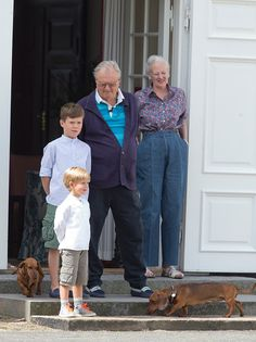 Prince Henrik, and Queen Margrethe of Denmark, with grandchildren, Prince Christian, and Prince Vincent view The Guard Change At Grasten Castle on July 24, 2015 in Grasten, Denmark.