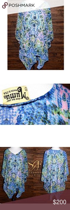 SHOW ME YOUR MUMU Classic Top Patterned Bohemian Size Medium. New Without Tags. $136 Retail + Tax.  • Beautiful printed peta tunic top featuring alternating lengths, oversized armholes & classic v-neckline.  • Unlined, loose-fitting silhouette. • Blue & green multi snake printed design throughout. • Perfect for pairing with denim or as a coverup. • Measurements provided in comment(s) section below.  {Southern Girl Fashion - Closet Policy}   ✔️ Same-Business-Day Shipping (10am CT). ✔️ Price…