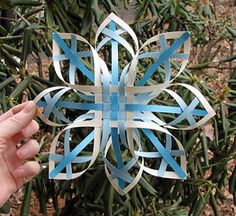 Woven paper snowflake (several different patterns) @Joy, I thought the kids might like this. :)