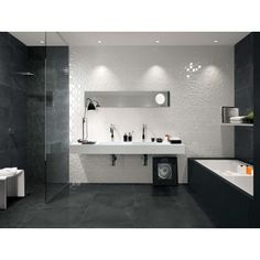 "Stunning bathroom featuring Lumina Italian porcelain wall cladding tile. Lumina Curve three dimensional white body wall tiles features unusual 3D structures to create an elegant and modern design.  In stock in 10""X30"" wall tile in both a gloss and matte finish.  Additional sizes available by special order; contact our sales department for full product details."