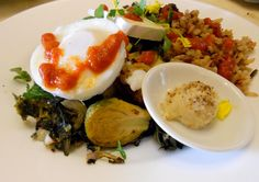 Brunch Time :: Avanti Bubble & Squeak :: Classic kale and chard saute / Roasted Yukon gold potato w/ vegan parsley buddah / Sake simmered Brussel sprouts / Brie cheese / Oven baked poached organic egg :: Served w/ Avanti brunch organic brown rice & black beans & Romesco sauce / Green peppercorn horseradish butter on the side #healthy #delicious #yum #veggie #brunch #vegitarian #natural #organic #Avanti #Brunch