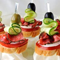 Canape of the baguette with salami on a glass base Canapes, Fruit Salad, Panna Cotta, Sandwiches, Cheesecake, Food And Drink, Party, Diet, Stock Photos