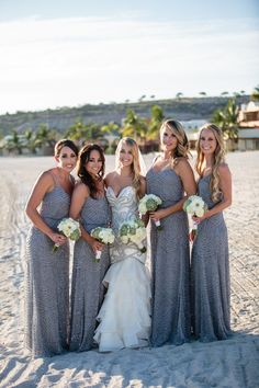 Bride and bridesmaids in silver theme wedding, wedding gown by St. Pucchi Couture with silver motifs and Adrianna Papell Beaded Chiffon Blouson Dress grey.