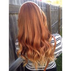 Natural looking colored red hair with balayage and soft waves