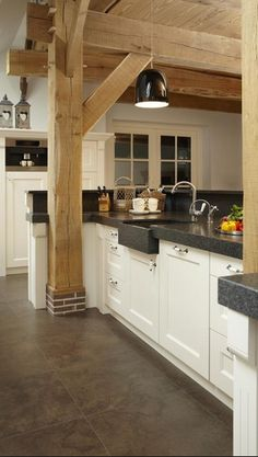 Hewn beams in kitchen. How do we get our beams to be hewn?
