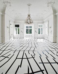 Esther Stocker, o e lascia dir le genti 2011, masking tape on carpet, 7,32 x 10,7 m,  Istituto Italiano di Cultura, Palais Sternberg, Wien. Photo: Iris Ranzinger