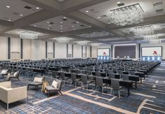 Escape to Chicago Marriott Downtown Magnificent Mile, featuring chic hotel accommodations, dining and scenic views of the lake, city and Mag Mile. Led Fixtures, Cheap Travel, Light Decorations, Guest Room, Chicago, Classroom Setup, Chandeliers, Table, Chandelier