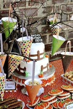 Pumpkin patch birthday party. (I love the cones hanging from the branches holding popcorn. So cute, clever and inexpensive. All you need is scrapbook paper, ribbon and a hole punch.-CGT)