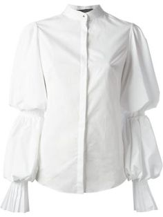 White cotton ruffle cuff shirt from Alexander McQueen featuring a high standing collar, long wide sleeves and a concealed front button placket. £481.12 by farfetch