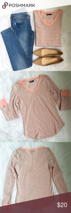 "Salmon Striped V-Neck BDG // Urban Outfitters // never worn // lived in type cotton soft material // v-neck and long sleeved // perfect top for the coming fall season // made to look kind of ""pilly""-- isn't from wear // doesn't have tag with material details // no trades BDG Tops Tees - Long Sleeve"