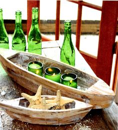 Wood Display Boats. Whatever floats your boat. Display seashells, sealife or coral; use on the deck to contain sunblocks and sunglasses; use in the bath with rolled handtowels or create a votive candle centerpiece. Anything you can come up with to store or display, these boats will carry the load.