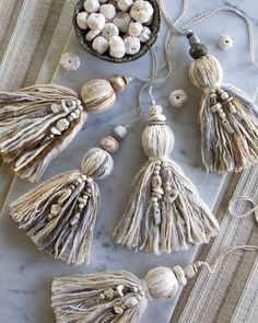 T A S S E L S // Plump and abundant, adorned with a mix of handmade and gemstone. T A S S E L S // Plump and abundant, adorned with a mix of handmade and gemstone beads. We will be making our first Wood Bead Garland, Beaded Garland, Diy Tassel, Tassels, I Love Jewelry, Diy Jewelry, Handmade Jewelry, Jewelry Logo, Earrings Handmade
