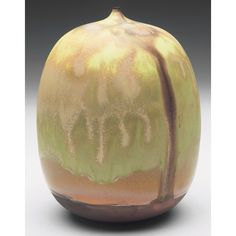 rose cabat feelie vase, bulbous shape covered in a yellow,green and brown matte glaze