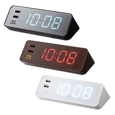An electronic LED clock with a USB power supply port. Tired of always having to find a separate outlet for your phone or camera? Suitable for the desk or your bedside table, the sleek, modern alarm clock incorporates 2 USB outlets that are perfect for charging an iPhone or ay other device supported by a USB charge.  White one!!!