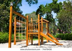 A big wooden children playground equipment shutterstock.com