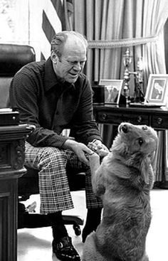 Gerald Ford and his dog, Liberty, having some fun in the Oval Office