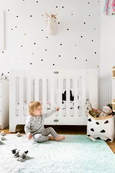 This nursery is teeny tiny, but you'd never know it looking at how light and bright they made the space!