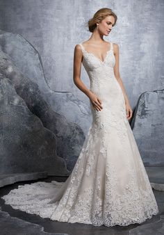Mori lee by Madeline Gardner Spring 2018 Elegant Fit and Flare Wedding Dress Featuring Frosted, Venice Lace and Embroidered Appliqués on Net with a Wide Scalloped Hemline. An Open Back Trimmed in Covered Buttons Trims the Back. Mori Lee Wedding Gowns, Mori Lee Bridal, Wedding Gown Sizes, Wedding Dresses 2018, Wedding Dress Styles, Designer Wedding Dresses, Bridal Dresses, Bridesmaid Dresses, Lace Mermaid Wedding Dress