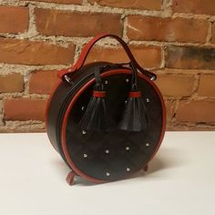 """45 Likes, 5 Comments - Amy Steele (@amysteelebags) on Instagram: """"I carried this little prototype on Saturday night. Circles are fun! #Handmade #Handbags…"""""""