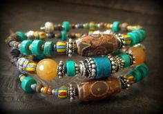 African, Tribal, Boho, Coral, Dzi Agate, Jade, Turquoise, African Beads, Czech Glass, Bolo Leather , Beaded Memory Wire,Wrap, Charm Bracelet by YuccaBloom on Etsy