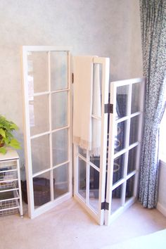 Three old salvaged windows and old hinges, the mixed sizes of windows make it fun. kim*