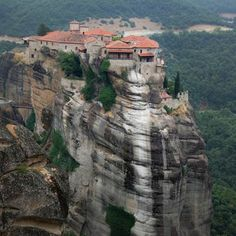 "No Photoshop trickery here! These are real, inhabited buildings built right up to the edge of a nearly 1,000 foot cliff drop. The strange Greek mountain formations of the Meteora (Greek for ""in midair"") have been home to monks since at least the 11th century. 