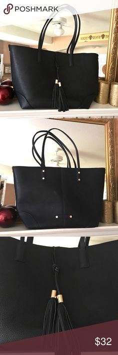 Extra Large Dark Navy Tote & Tassel Bag Not sure why this Tote shows to be black. It's a dark navy and beautiful if I must say. Looks new. Bags Totes