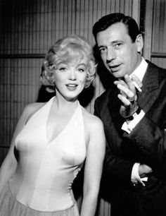 Marilyn Monroe and Yves Montand photographed at a press conference for Let's Make Love, 1960.