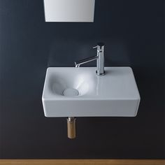 Space-saving small square white ceramic wall mounted or vessel bathroom sink with right counter space. Sink has one faucet hole. Sink is made of high-quality ceramic in a white finish. Perfect for modern bathooms. Made in Italy by Scarabeo. Pedestal Sink, Vessel Sink, Bathroom Faucets, Cuba, Space Saving Bathroom, Bathroom Small, Basement Bathroom, Bathroom Ideas, Floating Sink