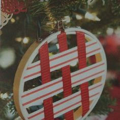 Handmade ornament using embroidery hoop and ribbon. Make an oversized one to hold cards?
