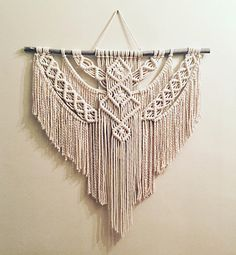 Large Macrame Wall Hanging This piece was created with a large, soft rope making it hang effortlessly. All sticks/branches are gathered and carefully selected by me. Hand-crafted with 100% natural cotton cord. **** COLOR and SIZING: Beige Width of Stick: 38 Macrame: 38 Rope