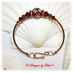 Designs by Debi Handmade Jewelry Red, Blue and Yellow Aloha Floral and Swarovski Crystal Siam Red Bicones Gold Plated Curved Tube Fitted Bangle Bracelet with Hook Clasp $21
