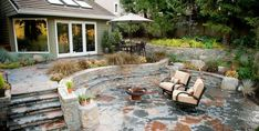 Creative of Stone Backyard Patio Ideas Flagstone Patio Benefits Cost Amp Ideas Landscaping Network - Several of the very best advancements and layout ideas Stone Backyard, Terraced Backyard, Outdoor Stone, Outdoor Fire, Sloping Backyard, Stone Patios, Outdoor Walkway, Paver Walkway, Walkways