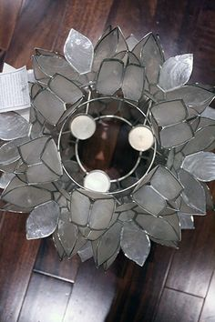 Make your own hanging light out of capiz shells. Beautiful end result, easy steps!