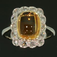 Antique jewelry Estate engagement ring with cabochon citrine and rose cut diamonds