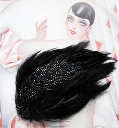 A stunning and chic hair clip inspired by the one and only Louise Brooks! Hollywoods cutest flapper girl!    Lovely black coque feathers decorated