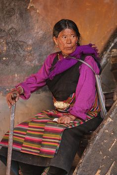 Pilgrim lady in pink resting on a staircase by Raphael Bick on Flickr - Rikaze, Tibet