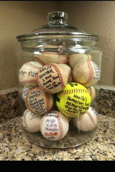 Jar of home run balls displayed on the counter instead of tucked away in a drawer.