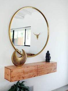 L I V I N G R O O M // Round mirror in brass by Sissy-Boy