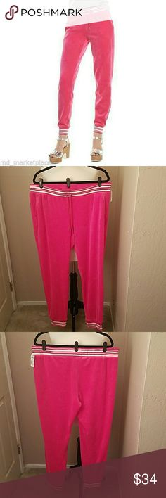 """NEW💗JUICY COUTURE JOGGER PANTS You'll be cute😊and comfortable☁ in these Juicy Couture velour jogger pants!  They have a ribbed lurex trim with silver metallic and white stripes, 2 pockets, a tapered cut from hip to hem, a drawstring elastic waist with the 'JUICY' logo on the tabs and the ribbed lurex hems deliver a modern look while also giving you a sporty feel.  HOLY MOLY! 😍  78% cotton 22% polyester...Approx. 32"""" inseam.  LOVE💞THESE...and you will too❣ JUICY COUTURE  Pants Track Pants…"""