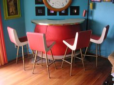 How totally amazing is this????  Vintage Retro Cocktail bar and four matching stools.  Looks like something straight out of the Jetsons and I can't find any other similar examples.  Would be PERFECT for any mid-century madmen modern retro vintage pad. Also great for your store, company, loft or office!!! Bar Measures 5ft wide by 42inches tall.  Awesome orange sputnik look to this with golden glitter in the formica on the bar top and foot rest.  This is rare, Rat Pack and very Shagalicious. $1500