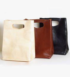 Leather Handbag   If the shape of this leather handbag looks slightly familiar, ...   Tote Handbags