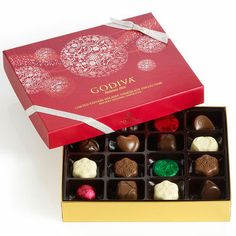 Godiva Holiday Assorted Chocolates Gift Box of 16 Chocolates SKU: GD8229 Let it snow, indeed! The fire is even more delightful when you share our festive 16-piece collection of assorted Ballotin classics plus holiday-exclusive milk and dark chocolate creations. Presented in a festive, snowflake-adorned red box. Includes these pieces:      Mocha Snowflake     Mandarin Snowflake     Dark Medallion in Green Foil     Milk Medallion in Red Foil     White Ganache Bliss